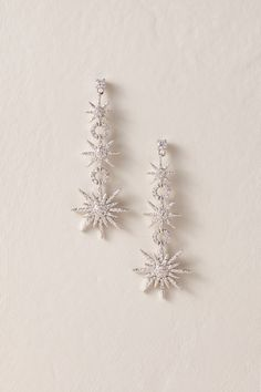 Wedding Earrings BHLDN's Jardin Milky Way Drop Earrings in Silver - Tiny crystals twinkle from a trio of starbursts, linked by dainty hoops. By Jardin Style Silver Drop Earrings, Cute Earrings, Bridal Earrings, Beautiful Earrings, Silver Necklaces, Bridal Jewelry, Silver Jewelry, Silver Ring, Prom Earrings