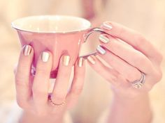 A metallic manicure for a bride at her modern wedding.