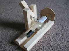 Wine Bottle Cutting Jig - when I make one, it will have a lazy susan for the base and a nozzle that goes into the bottle opening so that oval/square/odd shaped bottles can still be cut.