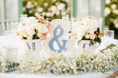 Anthropologie mugs with flowers and ampersand signs are the centerpieces of the sweetheart table. Pie Shoppe Photography