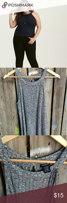 Ribbed Knit High Neck Tank Top Gently used   Up to the neck in style is taken literally on this tank top. The marled black and gray ribbed knit is totally sophisticated, yet stays in the comfort zone (it's super stretchy). The high neck silhouette is a covered-up contrast to the keyhole cutout back. torrid Tops Tank Tops