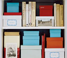 Colorful shoe boxes for storage on a bookcase