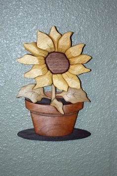 """This an intarsia piece I did in 2011. It is called """"Sunflower"""" The pattern is from Kathy Wise's book, Intarsia Woodworking for Beginners.  The piece is 11"""" x 7"""", has 28 pieces. The woods used are yellowheart, cherry, walnut, poplar, wenge, mahogany  Sunflower - Intarsia - by Jim @ LumberJocks.com ~ woodworking community"""