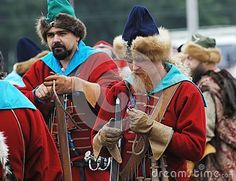 RUSSIA, MOLODI VILLAGE - JULY 27: Unidentified people in retro costume is Ignition wicks on event dedicated to Victory in battle near the Molodi village 1572, on July 27, 2013, in Moscow region, Russia Зажечь фитили