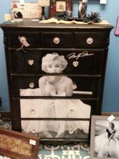 Marilyn Monroe. Saw this amazing dresser in a consignment shop today! Believe it is made by using decoupage to attach a cut up poster onto the dresser & then using blingy drawer pulls. Great idea!