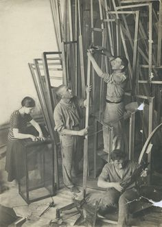 Tatlin (center) and assistants working on constructing a model of the tower in 1920.
