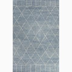 Inspired by simple nomadic design this rug is hand knotted in soft hand spun wool with a shaggy pile. It reflects the current trend for all things Moroccan . It is casual, with a super soft hand feel....