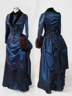 1883 day dress- This would look nice in royal purple, in my opinion, with black faux fur trim, depending on the season and weather.