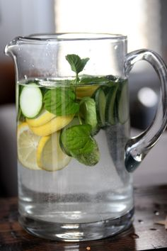 Add one sliced cucumber, half of a lemon, sliced, and several sprigs of mint to a liter jar (we used a large mason jar). Fill with water and let steep over night. Enjoy.