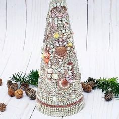 This one of a kind Christmas tree is really special, ( If I may say so myself:) It is 12 tall and 4 across the base. Ive used so many baubles, its a stunner from every angle, Materials include; vintage glass cabochons, porcelain roses, cherubs, resin flowers, german glass glitter, opal white Jeweled Christmas Trees, Cone Christmas Trees, Valentine Decorations, Christmas Decorations, Raw Gemstone Jewelry, Cone Trees, Resin Flowers, Cherubs, Roses