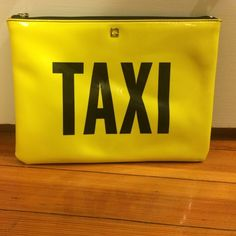 """Kate Spade New York Taxi Clutch Kate Spade New York Taxi Clutch. Patent faux leather with parent trim. Flat ouch with a zip top closure details. 7''h x10.2""""w 0.6""""d kate spade Bags Clutches & Wristlets"""