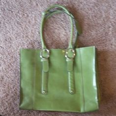Green tote bag purse In used but good condition. Several small scuff marks. Not very noticeable. Biggest flaw is in 4th pic. Pen mark and scuff. Beautiful green color, inside is a black and grey patterned lining. Purse has a snap closure. Two zippered pockets inside, 2 small open pockets good for cellphone or small item, 2 large open pockets. mondani new York  Bags Shoulder Bags