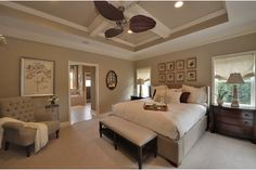An elegant palette of taupe and cream creates a tranquil owner's suite in the Madison model. Newly built homes by Schell Brothers at Heritage Creek. Milton, DE.