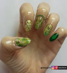 "Thumb, middle & ring with nude as base with dry brush design using light green, dark green & white. Gold stud added near cuticles. Pointer with all over white matte & gold sparkle sponged on for opacity. Pinky with dark green as base with vinyl green clover to finish. Nail Polish/ Products: NCLA NCLA209TJ ""Pisces"", Ruby Kisses HDP18 ""Whiter than White"", Joe Fresh ""Lime Juice"", Kleancolor 109 ""Green Grass"" & 291 ""Everyday is My Birthday"" (sparkle) & Beyond the Nail green vinyl clovers -March…"