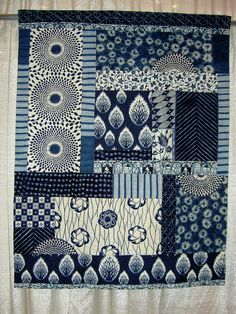 African Odyssey II, via Flickr. Such pretty fabrics in this quilt.