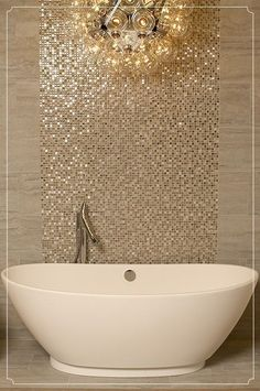 Pretty champagne colored mosaic tiles behind stand alone tub. Adds a touch of fa… Pretty champagne colored mosaic tiles behind stand alone tub. Adds a touch of fancy 🙂
