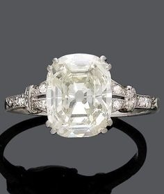 JANESICH - AN ART DECO DIAMOND RING, CIRCA 1925. Set to the centre with an oval mixed-cut diamond, weighing 3.30 carats, the shoulders set with 22 single-cut diamonds, mounted in platinum. Signed Janesich, indistinct numbers. #Janesich #ArtDeco #ring