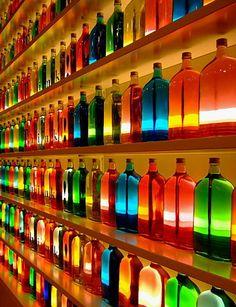Rainbow of bottles.