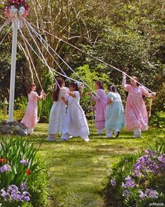 Dancing around the Maypole.  I did this several times as a child...so much fun!