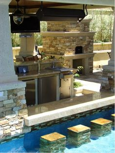 pool with swimup bar outdoor fireplace and kitchen!!! Oh yeah!