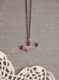the tiny whale necklace.