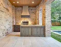Outdoor kitchen cabinet. Outdoor kitchen with reclaimed wood cabinet. Reclaimed wood cabinets for outdoor kitchens. #reclaimedwoodcabinet #outdoorkitchencabinet #outdoorkitchen Elizabeth Garrett Interiors.