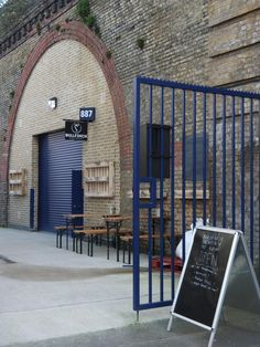 Railway arch at Rosendale Road between Herne Hill and Tulse Hill, near Brockwell Park, houses Bullfinch Brewery Tap. The brewery is housed in adjacent arches (not visible from within the taproom).