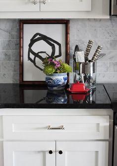 marble backsplash, polished black granite, white cabinets