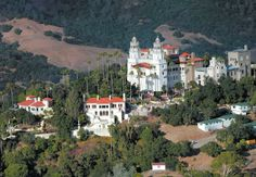 """Hearst Castle, 1919  San Simeon, Calif.  William Randolph Hearst asked architect Julia Morgan to design """"a little something"""" to replace the tents at his family's summer camp. The Mediterranean Revival palace hosted A-listers such as Winston Churchill and Charles Lindbergh.  Joe Johnston/The Tribune/AP Photo"""