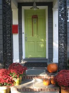 Love the dark paint & green door!