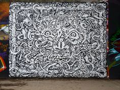 Psychedelic faces, sea creatures, reptiles, extraterrestrial beings, and more in this new piece by Paris street artist, Nosbe. Get lost in the labyrinth!