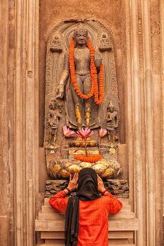 Offering prayers.