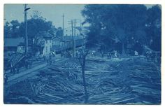 Remains of a lumber yard in Mechanicsburg PA (Cumberland County) after a fire. CVRR (Cumberland Valley Railroad) tracks and industrial buildings can be seen off to the left. Rare cyanotype view of Mechanicsburg.