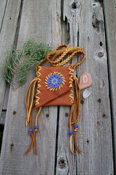 Excited to share the latest addition to my #etsy shop: Beaded amulet bag , Beaded Necklace bag , Native medicine pouch, Tribal bag https://etsy.me/2wibIwh #bagsandpurses #beadedamuletbag #medicinebag #beadedmedicinebag #specialkeepsakebag #necklacebag #leatherbag Leather Cuffs, Leather Pouch, Leather Necklace, Leather Jewelry, Leather And Lace, Beaded Necklace, Beaded Jewelry Patterns, Little Bag, Native American Medicine Bag