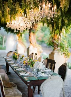 elegant and yet also a bit shabby chic outdoor wedding decor, love the chandeliers