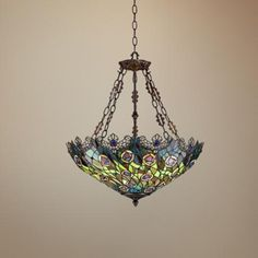 Glass pendants add a warm glow to your decor. This stunning pendant chandelier provides warm, overall lighting with Tiffany style glass pieces.