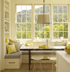 Kitchen eating nook.  Love the windows, built in seating.  Such a neat place to gather as a family every day.
