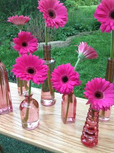Hot Pink Gerbera Daisies would be in turquoise glass with some bling