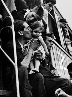 © robert capa, barcelona, spain — bidding farewell before the departure of a military train directed to the aragon front, august 1939