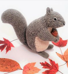 Knitting Pattern for Backyard Squirrel - This toy squirrel softie is 7 inches tall with worsted weight yarn. The body is worked flat, with short rows creating the curved back. The legs, tail and head are worked in the round. Eyes and nose are embroidered. Designed by Sara Elizabeth Kellner