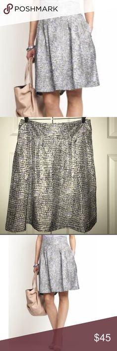 """🍦BANANA REPUBLIC🍦SILK PRINTED SKIRT🍦 Banana Republic 100% silk skirt with 😍POCKETS😍. Varian colors of gray banana republic call some of this gray shark grey. Stunning square pattern that has the grays whites and lilac blend it just right.  back zipping. Fully lined lining is 100% acetate. Waist 16"""", hips 23"""", length 23"""" Banana Republic Skirts Midi"""
