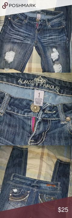 Almost famous skinny super distressed jeans size 1 Beautiful jeans , just too small now , super distressed , if you don't like skin showing , through your jeans don't buy , these have holes(distressed) 😇😍 Almost Famous Jeans Skinny