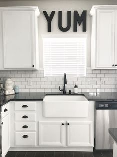 Black White and Teal Kitchen. SOURCE: lollipopsandlightsabers black and white modern farmhouse farmhouse sink subway tile black granite black hardware white cabinets whirlpool appliances teal pantry door fresh pies rae dunn YUM. Farmhouse Kitchen Cabinets, Modern Farmhouse Kitchens, Home Kitchens, Farmhouse Style, Farmhouse Sinks, Kitchen Sink, Farmhouse Door, Farmhouse Ideas, Kitchen Pantry