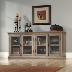 Features:  -Embossed top.  -Framed and safety-tempered glass doors.  -2 Adjustable shelves.  -Enclosed back panel with cord access.  -Made in the USA.  -Safety glass doors do not interfere with using