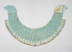 2040-1783 BCE. This broad collar with falcon head terminals is made of