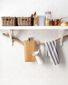 A Pretty Storage Idea: Use a Branch To Hold Lightweight Kitchen Items. This is such a simple idea! Take a sturdy branch or piece of driftwood and thread it through open wall brackets to create a nature-inspired rail. It's perfect for holding lightweight items like dish towels, pot holders, or small cooking tools.  Martha Stewart recommends hanging items with S hooks and twine. Just one more way to create some extra storage space in your kitchen. Pretty!