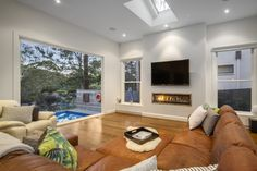 Open Living Area overlooking the pool and the sloping block