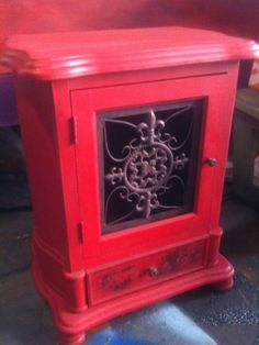 """An """"upcycled"""" handpainted cabinet.  Lovely cast iron door.  If I could find the right piece I could do this myself."""