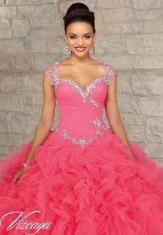 Quinceanera Gowns Style 89033: Beaded Tulle with a Ruffled Ball Gown Skirt.  http://www.morilee.com/quinceanera/quinceaneravizcaya/89033