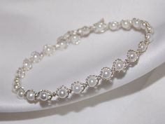 Silver Plated 5 Strand Twist White Pearl Bracelet    This bracelet is very beautiful and, do to its size, can be worn for any occasion from a